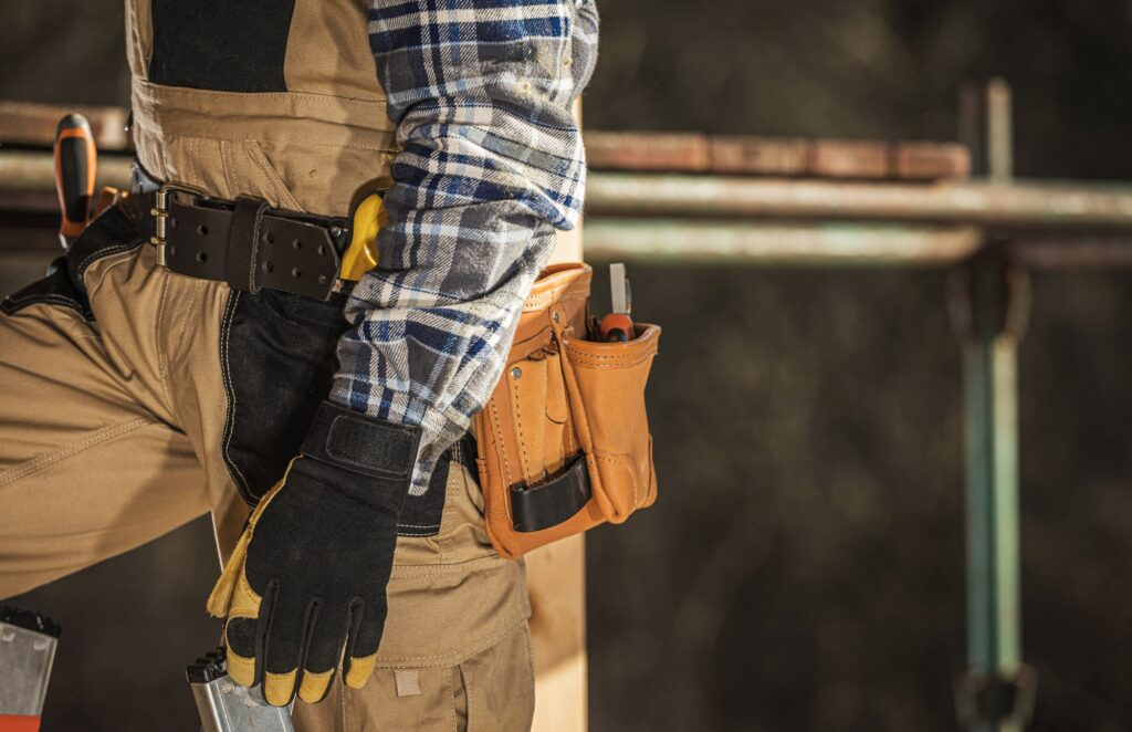 Close Up Of Construction Laborer With Tool Belt Around Waist.