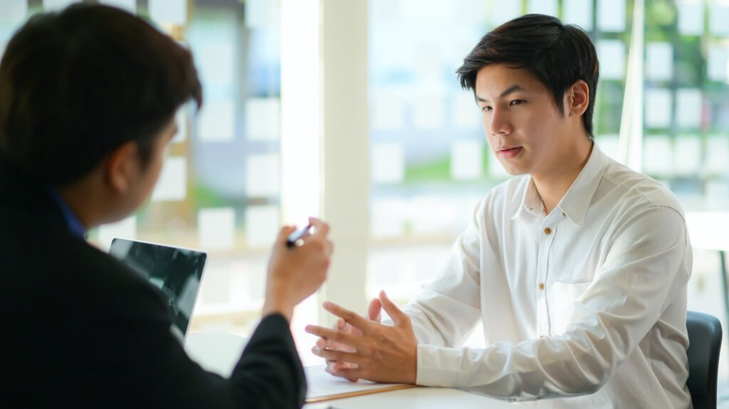 Interviewing job seekers presenting their resume for executives to consider.