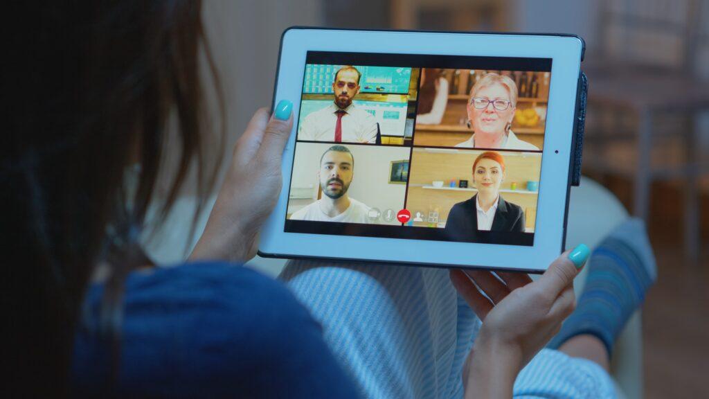 Woman listening online training on tablet